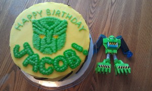 Boulder the Rescue Bot Birthday Cake: Yellow and Green with Black Hazard Stripes on the Side